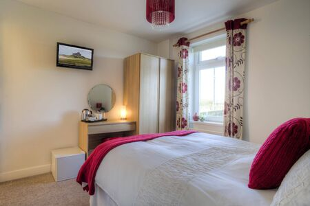 double room: Double room decorated with pink furnishings.