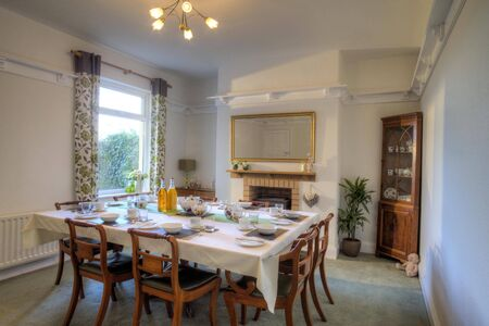 room to let: Dining room with a table which has been laid for a meal.