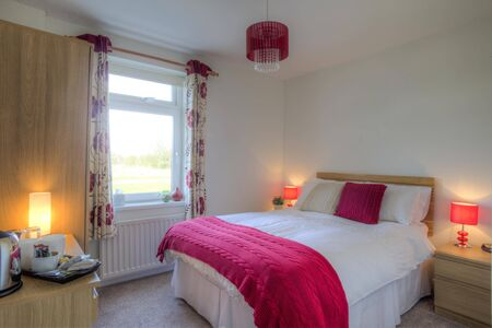 room to let: Double room decorated with pink furnishings.