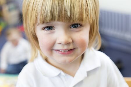 Portrait of a young boy at nursery.