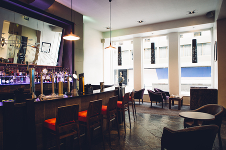 in low spirits: Full room shot of an empty bar. Stock Photo