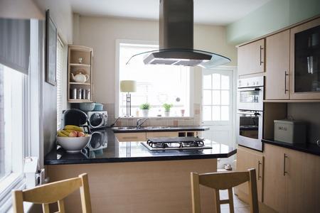 worktops: Horizontal image of an empty domestic kitchen. Stock Photo