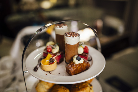 Close up shot of sweet treats on an afternoon tea platter.