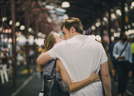 Happy couple kissing in Queen Victoria Market, Australia.
