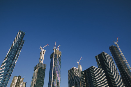 Cityscape of skyscrapers with cranes in Melbourne, Australia