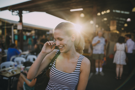 Happy young backpacker is exploring Queen Victoria Market in Australia Stock Photo