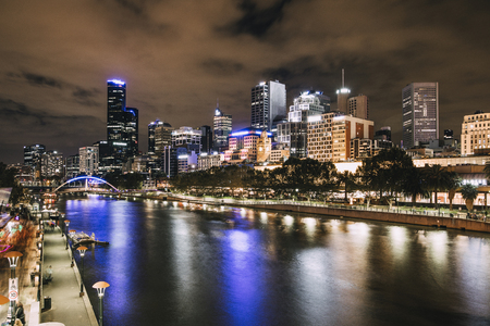 Night shot of Yarra river and Melbourne cityscape.