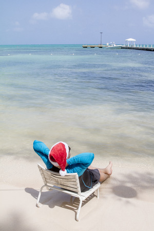 Senior man is relaxing on the beach in the Caribbean Islands at christmas.