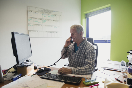 Businessman working in an office at home.