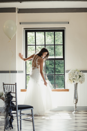 Young bride is having a moment to herself on her wedding day.