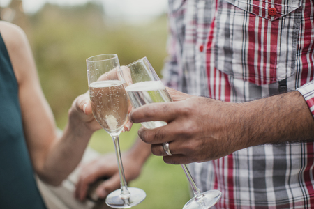 Couple making a celebratory toast with champagne.