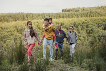 Family spending quality time together by hiking through the country side. Stock Photo