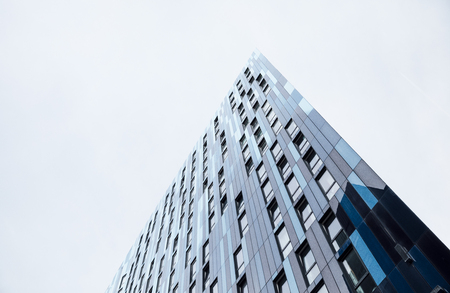 Low angle view of an office building in a city. Stock Photo