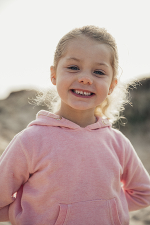 Portrait of a happy little girl on the beach. Reklamní fotografie