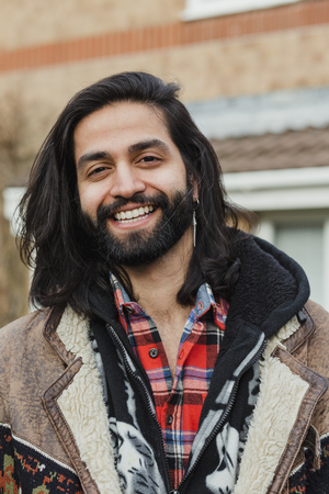 Portrait of mid adult man outdoors. Фото со стока