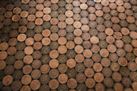 Abstract high angle view of a floor which has been made out of two pence coins. Stockfoto