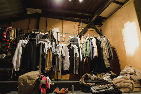 Pop-up dressing room with clothes on rails.
