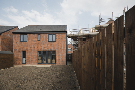 Exterior shot of a new build house in development.