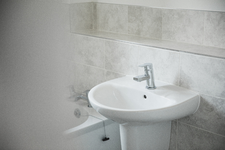 Close up shot of a bathroom sink in a new home.