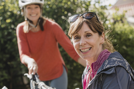 Headshot of a senior female cyclist looking at the camera and smiling. Stock Photo