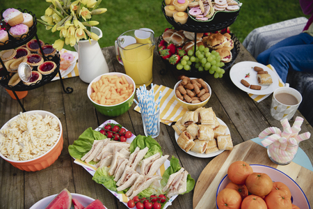 High angle view of a table outdoors with a variety of different foods on it.