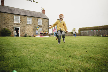 Children runnning as they search with excitement for chocolate easter eggs.