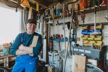 Portrait of a senior man in his wood workshop. Reklamní fotografie