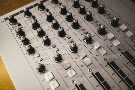A directly above shot of a sound mixer on a desk in a radio station studio. Banco de Imagens