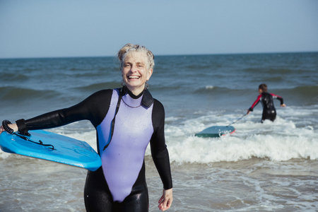 Portrait of a mature bodyboarder on the beach after being in the sea.