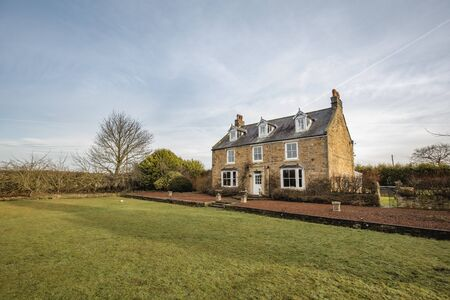 Wide angle view of the exterior of a country house in County Durham.