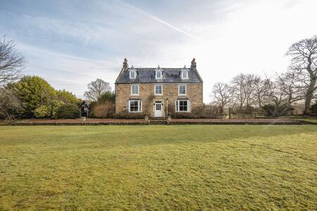 Wide angle view of the exterior of a country house in County Durham. 免版税图像 - 124813426