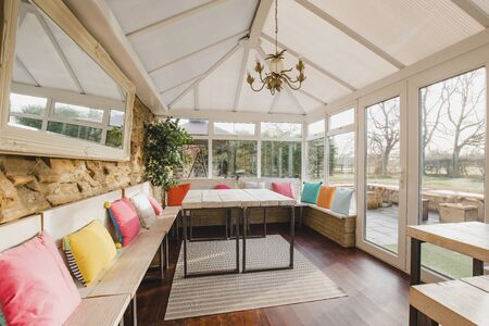 Wide angle view of the interior of a modern looking conservatory.