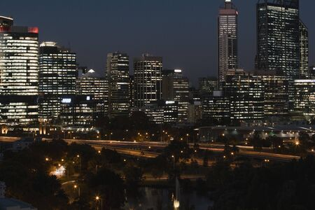 Wide shot of Perths illuminated skyline at night.