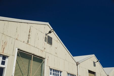 Low angle view of a corrugated iron industrial warehouse in Perth, Australia.