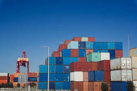 Wide angle view of stacks of shipping containers at a dock in Perth, Australia. Stock Photo