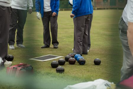 Bocce balls on a bowling green, in preparation for a lawn bowling game.