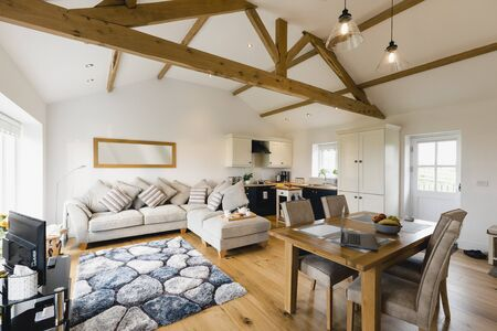 A wide-view shot of a modern living room and kitchen in Northeastern England. 版權商用圖片