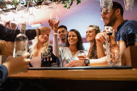 A group of friends havng drinks together in a bar. Stockfoto