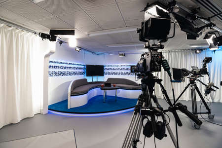 An empty film studio in Gateshead, Newcastle. It has sofas for the presenters with film cameras pointed at them, ready for filming.