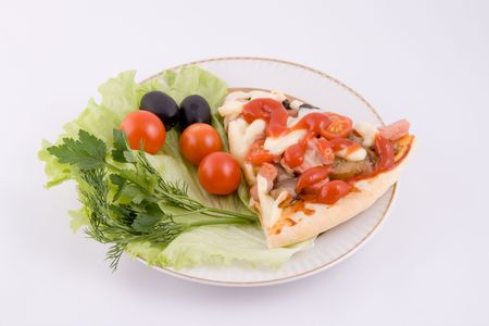 Piece of a pizza with vegetables on a plate on a white background photo