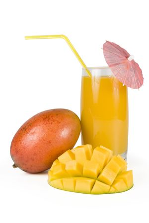 exoticism: Fresh, juicy, appetizing mango and glass of fresh juice with a straw, decorated with a decorative umbrella. Isolated on a white background