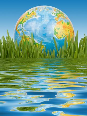 reflexion: El mundo en un c�sped verde sobre fondo azul con una reflexi�n en el agua.  Foto de archivo