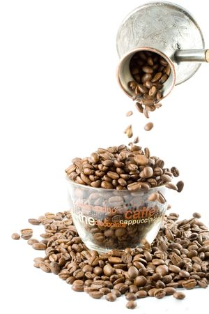 Coffee beans in a cup isolated on a white background photo