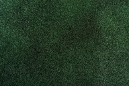 Natural dark green leather texture. Close up.