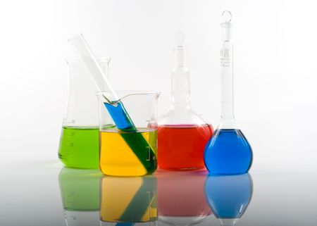 Various colorful flasks over white background Stock Photo - 2927007