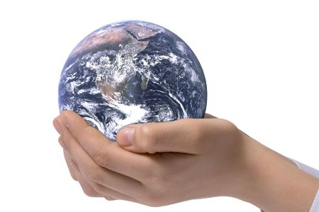 The globe in childrens hands. Concept for environment conservation. Stock Photo
