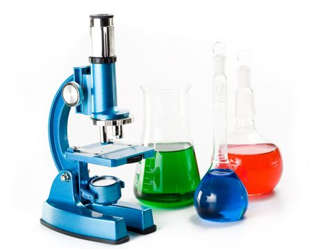 Vaus colorful flasks and blue microscope over white background Stock Photo - 2978505