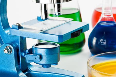 Vaus colorful flasks and blue microscope over white background Stock Photo - 2978518