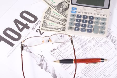 United States Tax Form, calculator, dollars and eyeglasses photo