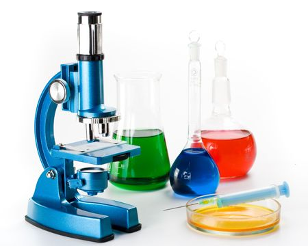microscope lens: Various colorful flasks and blue microscope over white background Stock Photo